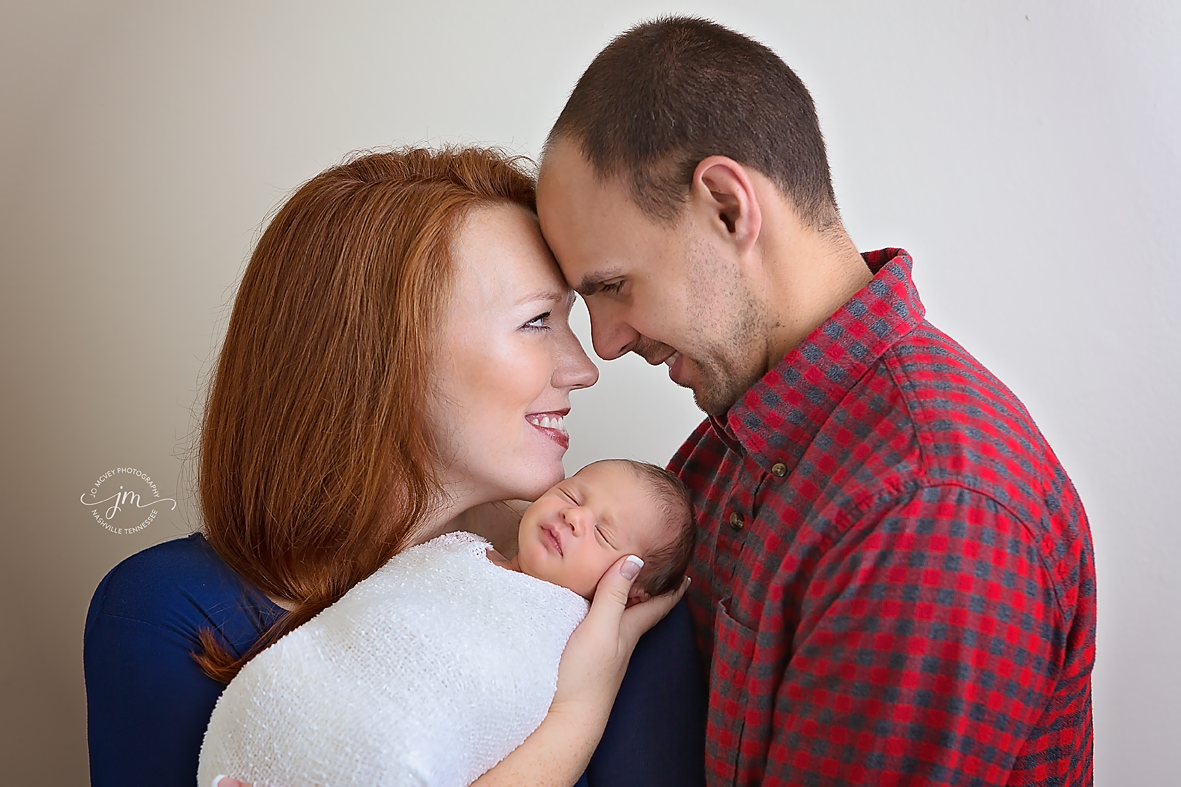 Family of 3 with newborn in studio - Nashville baby photographer