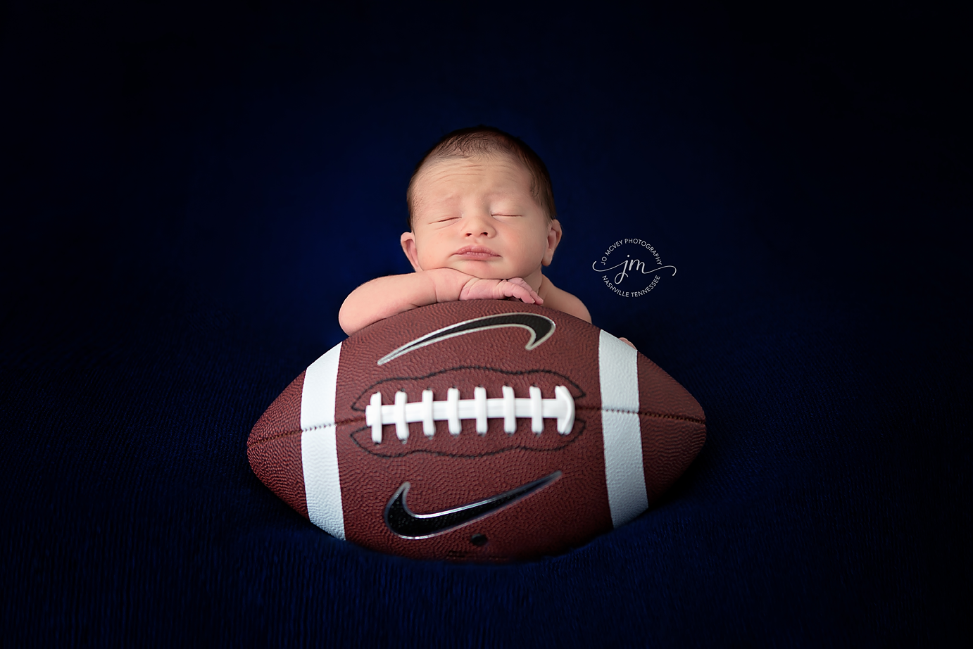 Newborn boy with football - Nashville Baby Photographer | Jo McVey Photography