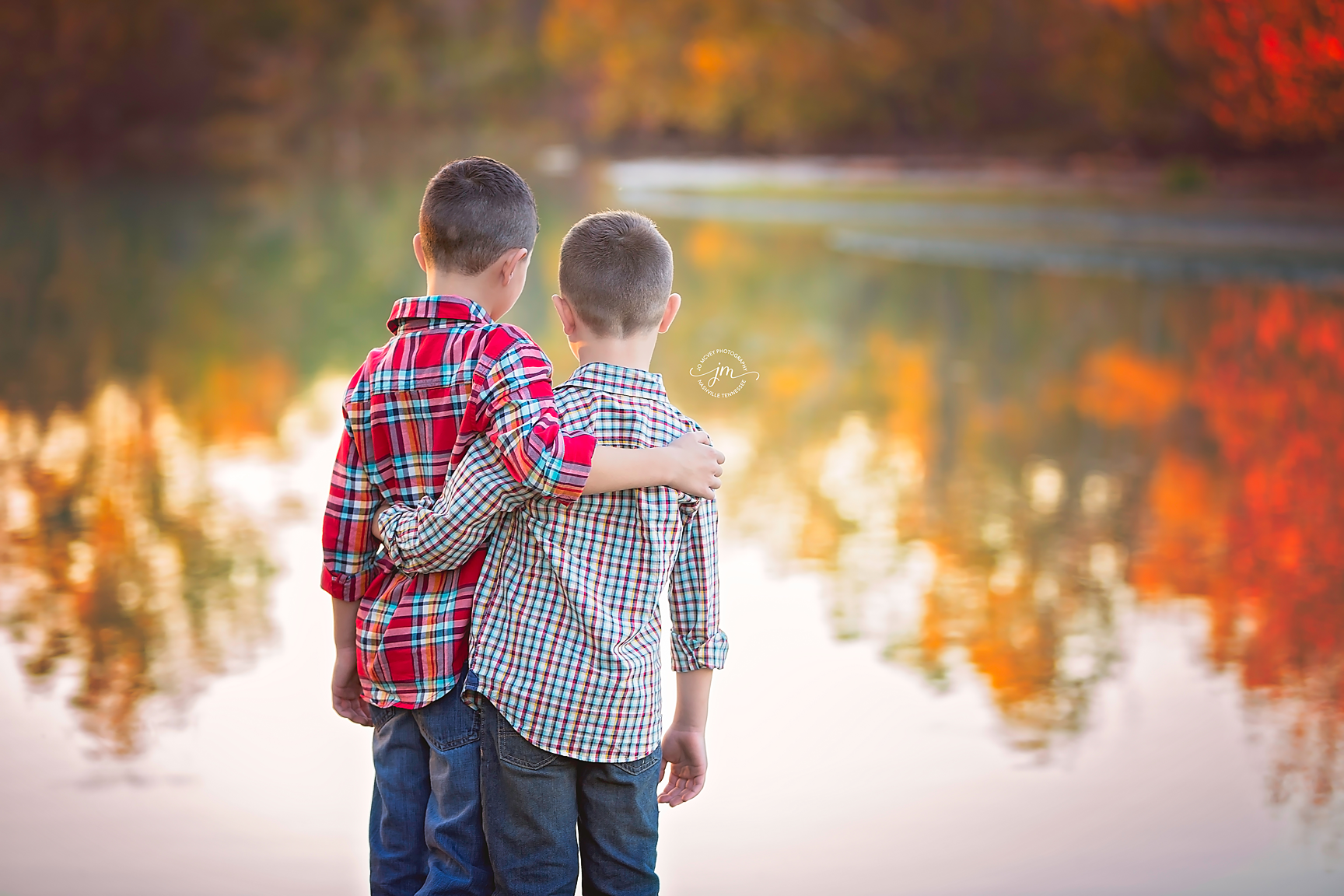 Brothers embracing by creek - Nashville Child Photographer | Jo McVey Photography