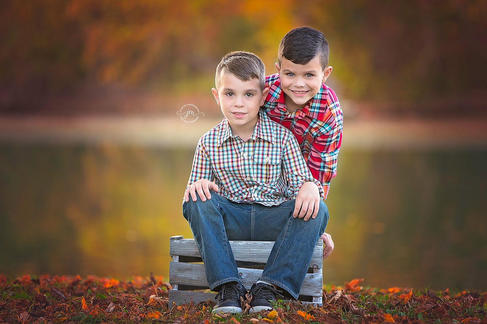 Brothers sitting on crate by creek - Nashville Child Photographer | Jo McVey Photography