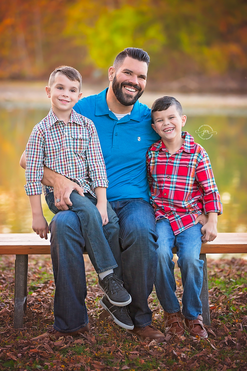 Father and sons sitting on bench by creek - Nashville Family Photographer | Jo McVey Photography