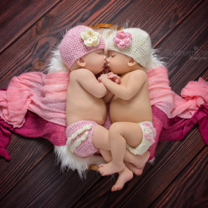 twin baby girls cuddling in basket - nashville newborn photographer