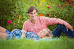 expecting mother and father in flower garden - Nashville Maternity Photographer