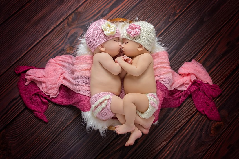 Twin baby girls sleeping and holding hands - Nashville Twin Photographer