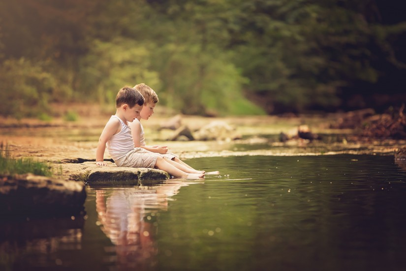 Little boys sitting with their feet in a creek - Tennessee Fine Art Portraits