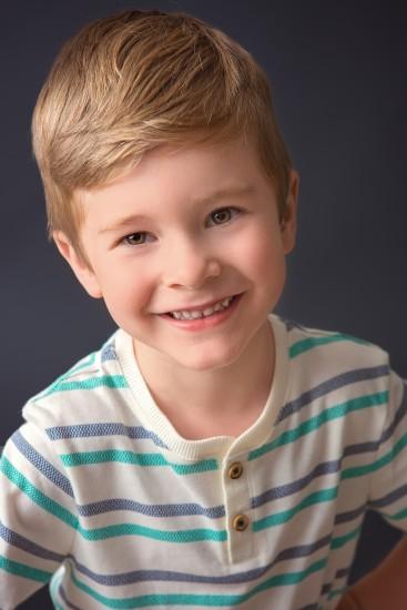 Headshot of 5 year old boy with dark gray background - Nashville Headshot Photographer