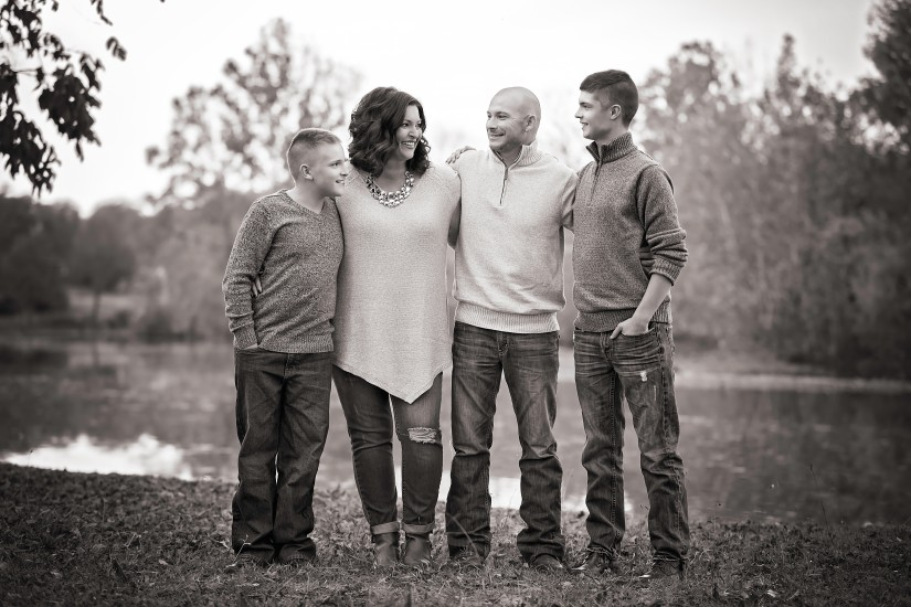 Black and white image of parents with two sons - Gallatin Family Photographer