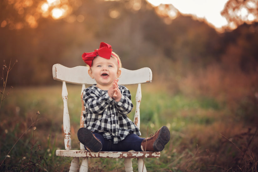 baby clapping on chair